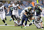 Seattle Seahawks wide receiver Golden Tate (81) is ridden down by Jacksonville Jaguars safety Josh Evan after catching a 20-yard pass for a first down during the second quarter at CenturyLink Field in Seattle, Washington on September 22, 2013. The Seahawks beat the Jaguars 45-17. ©2013. Jim Bryant Photo. ALL RIGHTS RESERVED.