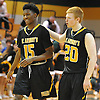 Josh Nicholas #15 of St. Anthony's, left, gets a pat on the back from teammate #20 James Walsh during the NSCHSAA varsity boys basketball semifinals against Chaminade at LIU Post on Sunday, Feb. 28, 2016. St. Anthony's won by a score of 73-54.