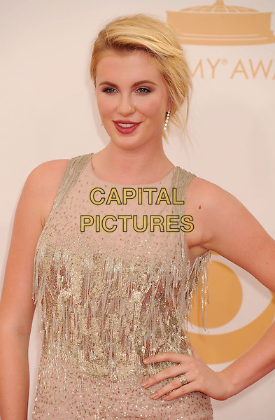 Ireland Baldwin<br /> arrives at the 65th Annual Primetime Emmy Awards at Nokia Theatre L.A. Live in Los Angeles, California, USA, <br /> September 22nd 2013. <br /> emmys arrivals half length beige nude dress hand on hip tassels beaded gold ring red lipstick makeup <br /> CAP/ROT/TM<br /> &copy;TM/Roth Stock/Capital Pictures