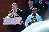Tuesday 11 March 2014<br /> Pictured: Dad Patrick Mullane (L) with Father Pius Augustine (R) carrying the tiny coffin of Eliza Mae after the service<br /> Re: A funeral has taken place  in Pontyberem Catholic Church for six day old Eliza-Mae Mullane who died after an incident at the family home in Carmarthenshire in the morning of 18 February 2014, where police later seized two dogs, an Alaskan Malamute called Nisha and a collie cross that were destroyed following the baby girl's death.<br /> Parents Sharon John and Patrick Mullane said previously that they would cherish the short time they had with her.