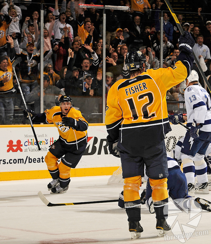 NASHVILLE, TN - OCTOBER 27:  Craig Smith #15 of the Nashville Predators celebrates a goal by teammate Mike Fisher #12 against the Tampa Bay Lightning at Bridgestone Arena on October 27, 2011 in Nashville, Tennessee.  (Photo by Frederick Breedon/Getty Images)