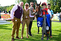 Trainer Richard Hughes and jockey Finley Marsh with connections of Beepeecee in the winners enclosure  during Afternoon Racing at Salisbury Racecourse on 13th June 2017