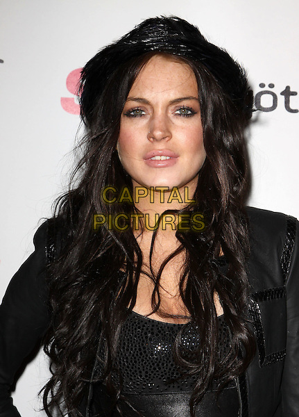 LINDSAY LOHAN.Star Magazine Celebrates Young Hollywood held at Voyeur, West Hollywood, California, USA..March 31st, 2010.headshot portrait half length black leather jacket hat .CAP/ADM/KB.©Kevan Brooks/AdMedia/Capital Pictures.