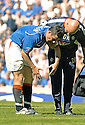 21/08/2005         Copyright Pic : James Stewart.File Name : jspa41 rangers v celtic.BARRY FERGUSON LIMPS OFF AFTER RECEIVING AN INJURY DURING A CHALLENGE BY BOBO BALDE WHICH HAS ALL BUT RULED HIM OUT OF THE CHAMPIONS LEAGUE QUALIFIER AGAINST FAMAGUSTA.... .Payments to :.James Stewart Photo Agency 19 Carronlea Drive, Falkirk. FK2 8DN      Vat Reg No. 607 6932 25.Office     : +44 (0)1324 570906     .Mobile   : +44 (0)7721 416997.Fax         : +44 (0)1324 570906.E-mail  :  jim@jspa.co.uk.If you require further information then contact Jim Stewart on any of the numbers above.........