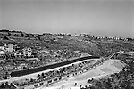 Israeli highway leading from the southern West Bank to Jerusalem and the settlement of Gilo as seen from Beit Jala near Bethlehem. 2008.