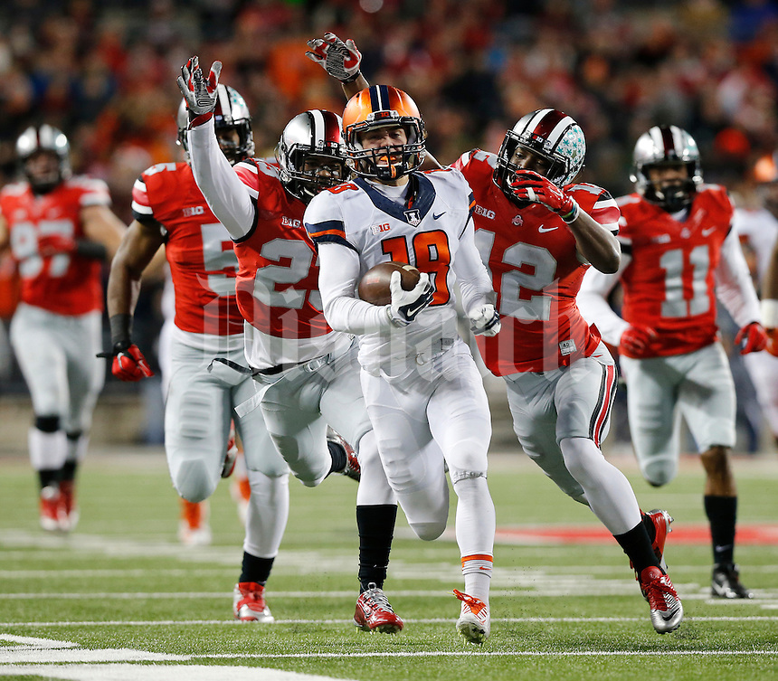 Ohio State Buckeyes safety Tyvis Powell (23), and cornerback Doran Grant (12) chase down Illinois Fighting Illini wide receiver Mike Dudek (18) after he made a reception during the first quarter of the NCAA football game at Ohio Stadium on Nov. 1, 2014. (Adam Cairns / The Columbus Dispatch)