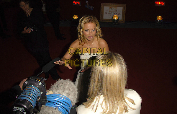 GERI HALLIWELL .Attending the Galaxy British Book Awards held at the Grosvenor Hotel, Park Lane, London, England, .April 9th 2008.half length hand being filmed camera interviewed microphone .CAP/CAS.©Bob Cass/Capital Pictures