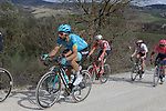 The peloton including Dario Cataldo (ITA) Astana Pro Team climb sector 8 Monte Santa Maria during Strade Bianche 2019 running 184km from Siena to Siena, held over the white gravel roads of Tuscany, Italy. 9th March 2019.<br /> Picture: Seamus Yore | Cyclefile<br /> <br /> <br /> All photos usage must carry mandatory copyright credit (© Cyclefile | Seamus Yore)