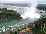 Aerial view of Horseshoe Falls and Goat Island at Niagara Falls from the Canadian side of the falls.