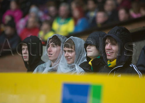 04.10.2014.  Norwich, England. Skybet Championship. Norwich City versus Rotherham United. The home fans are kitted out for the wet weather.