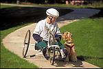 man riding recumbent bicycle with pet dog