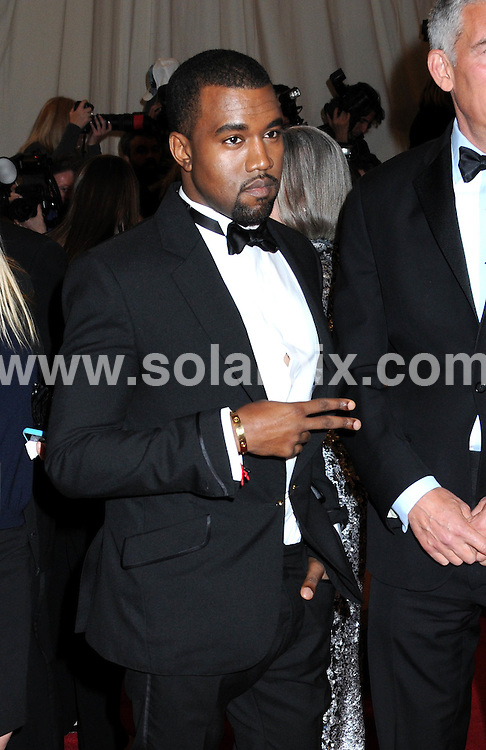 """**ALL ROUND PICTURES FROM SOLARPIX.COM**                                             **SYNDICATION RIGHTS FOR UK, AUSTRALIA, DENMARK, PORTUGAL, S. AFRICA, SPAIN & DUBAI (U.A.E) & ASIA (EXCLUDING JAPAN) ONLY**                                                                                  Caption:  """"Alexander McQueen: Savage Beauty"""" Costume Institute Gala at the Metropolitan Museum of Art  Arrivals The Metropolitan Museum of Art New York City, NY, USA                                                                             This pic:   Kanye West                                                                                           JOB REF:13262        PHZ       DATE: 02.05.2011                                                           **MUST CREDIT SOLARPIX.COM OR DOUBLE FEE WILL BE CHARGED**                                                                      **MUST AGREE FEE BEFORE ONLINE USAGE**                               **CALL US ON: +34 952 811 768 or LOW RATE FROM UK 0844 617 7637**"""