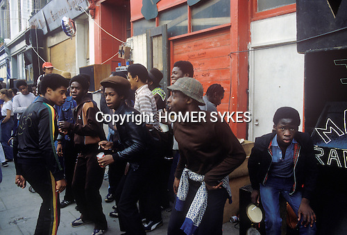 Notting Hill Carnival 1976 London. Black teens dancing.