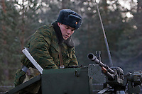 Kamenka, Karelia, Russia, 14/12/2007..A professional Russian soldier loading machine-gun on his armoured personnel carrier during Snezhinka [Snowflake] 2007, a joint live fire training exercise for Russian and Swedish motorised infantry in which they play the roles of a combined peace-keeping force enforcing a demilitarised zone in a warring region.