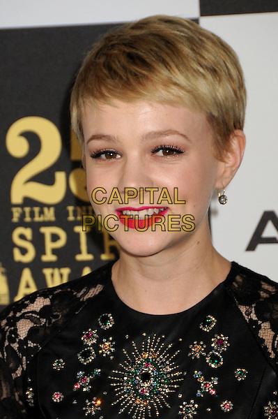 CAREY MULLIGAN.25th Annual Film Independent Spirit Awards - Arrivals held at the Nokia Event Deck at L.A. Live, Los Angeles, California, USA..March 5th, 2010.headshot portrait smiling pink red lipstick black leather pattern beads beaded lace .CAP/ADM/BP.©Byron Purvis/AdMedia/Capital Pictures.