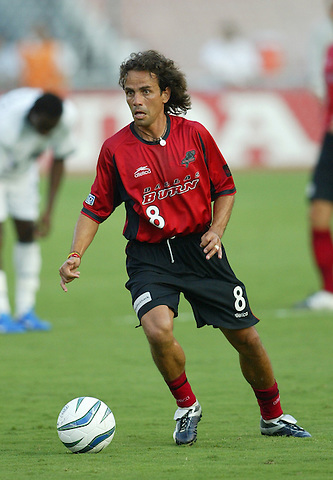 DALLAS, TX AUGUST 7:  Oscar Pareja #8 of the Dallas Burn in action against Colorado Rapids at Cotton Bowl in Dallas, Texas on August 7, 2004. (Photo by Rick Yeatts)