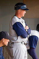 Charlotte Knights manager Joe McEwing #11 watches the action from the dugout during the International League game against the Pawtucket Red Sox at McCoy Stadium on June 14, 2011 in Pawtucket, Rhode Island.  The Knights defeated the Red Sox 4-2 in 11 innings.    Photo by Brian Westerholt / Four Seam Images