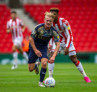 4th July 2020; Bet365 Stadium, Stoke, Staffordshire, England; English Championship Football, Stoke City versus Barnsley; Ben Williams of Barnsley wins the ball