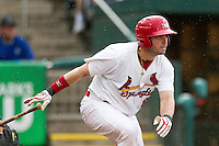 Chris Swauger (8) of the Springfield Cardinals follows through his swing during a game against the Northwest Arkansas Naturals at Hammons Field on July 31, 2011 in Springfield, Missouri. Northwest Arkansas defeated Springfield 9-1. (David Welker / Four Seam Images)