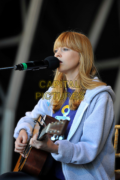 Lucy Rose<br /> attending The Big IF, Hyde Park, London, England. <br /> 8th June 2013<br /> half length profile purple fleece on stage in concert live gig performance performing music singing guitar <br /> CAP/MAR<br /> &copy; Martin Harris/Capital Pictures