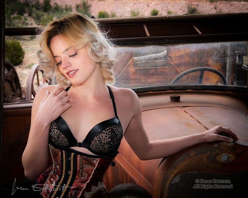 Violet at Gold King Mine ©2019 James D Peterson.  She goes by the stage name of Violet Pixie, and she's a very accomplished and creative model - not to mention gorgeous!  She's posing here by an antique pickup truck during a recent Red Bench Studio photo workshop at Gold King Mine in Jerome, Arizona.