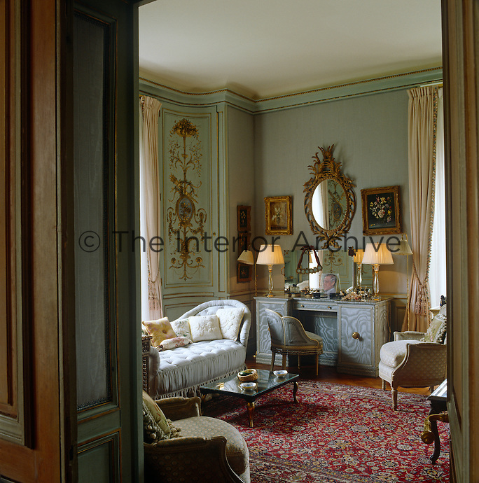 "In the Duchess of Windsor's bedroom the red tones of an elaborate Persian rug create a pleasing contrast to pale blue upholstery and walls painted a subtle turquoise, her favourite colour and known as ""Wallis Blue"""