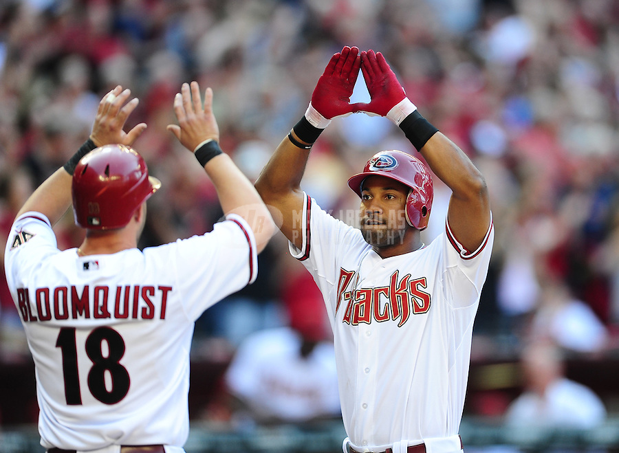 Apr. 6, 2012; Phoenix, AZ, USA; Arizona Diamondbacks outfielder Chris Young (right) is congratulated by teammate Willie Bloomquist after hitting a two run home run in the first inning against the San Francisco Giants during opening day at Chase Field.  Mandatory Credit: Mark J. Rebilas-