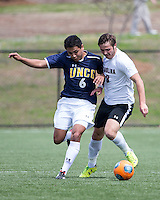 The UNC Greensboro Spartans played the University of South Carolina Gamecocks in The Manchester Cup on April 5, 2014.  The teams played to a 0-0 tie.  Aaron Reifschneider (6), Kurtis Turner (8)