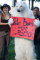 "Person in polar bear costume with ""Polar bears need us to get to 350"" sign. Hundreds of people gathered in downtown San Francisco for 350.org's International Day of Climate Action, October 24, 2009. Greenpeace, Mobilization for Climate Justice, and many others helped put on the local event. California, USA"
