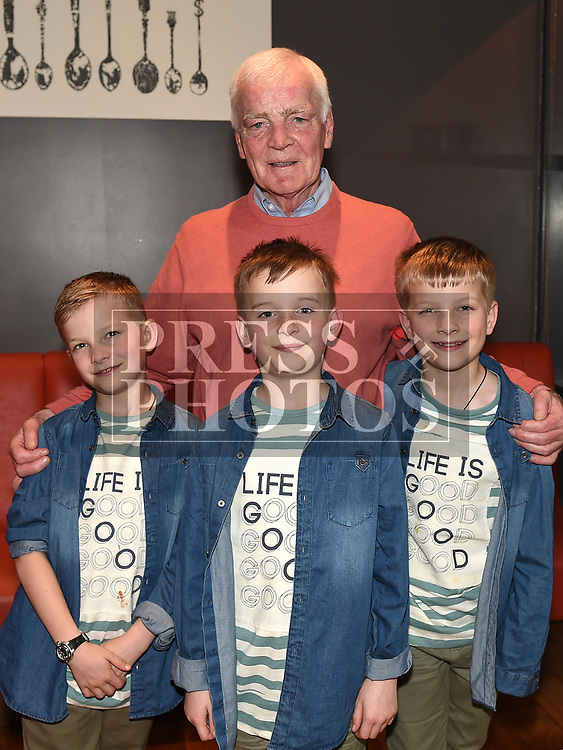 Noel Smokey Kierans at his retirment party in Brú with his grandchildren Ethan, Eoin and Michael. Photo:Colin Bell/pressphotos.ie