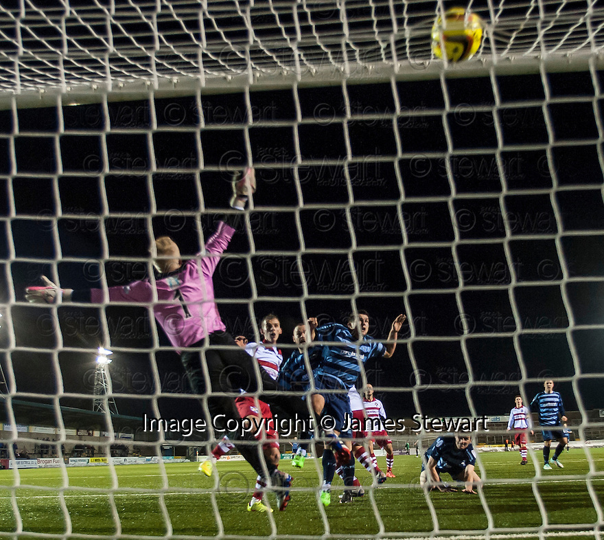 Forfar's Martyn Fotheringham (centre) scores their second goal .