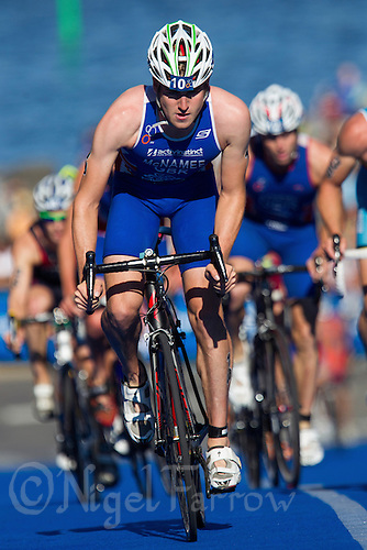 25 AUG 2013 - STOCKHOLM, SWE - David Mcnamee (GBR) of Great Britain climbs a hill during the bike at the men's ITU 2013 World Triathlon Series round in Gamla Stan, Stockholm, Sweden (PHOTO COPYRIGHT © 2013 NIGEL FARROW, ALL RIGHTS RESERVED)