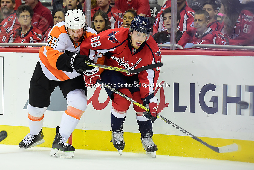 Friday, April 22, 2016: Philadelphia Flyers center Ryan White (25) tries to stop Washington Capitals defenseman Nate Schmidt (88) from passing the puck during game 5 of the first round of the National Hockey League Eastern Conference playoffs  between the Philadelphia Flyers and the Washington Capitals held at the Verizon Center in Washington, DC. The Flyers defeat the Capitals 2-0. Eric Canha/CSM