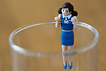 "A figure of ""Cup no Fuchiko"" climbs on the side of a glass on August 19, 2014 in Tokyo, Japan. These mini figures are popular amongst young Japanese women who often use them when composing pictures of their lunch. The name Cup no Fuchiko translates to  or ""office lady, or OL, on the side of a cup"" and the figures are sold as drink ornaments. Made by  Kitan Club CO. LTD Cup no Fuchiko was created by the manga artist Katsuki Tanaka. There are currently 21 models of Cup no Fuchiko and Kitan Club has also made capsule toys from famous characters such as Street Fighter II, Moomin, Hello Kitty. (Photo by Rodrigo Reyes Marin/AFLO)"