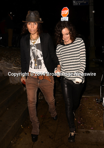 Pictured: Linda Perry, Sara Gilbert<br /> Mandatory Credit: Luiz Martinez / Broadimage<br /> Annie Leibovitz Book Launch - Outside Arrivals<br /> <br /> 2/26/14, West Hollywood, California, United States of America<br /> Reference: 022614_LMLA_BDG_098<br /> <br /> sales@broadimage.com<br /> Bus: (310) 301-1027<br /> Fax: (646) 827-9134<br /> http://www.broadimage.com