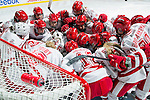 Wisconsin Badgers women's hockey team huddles prior to an NCAA women's hockey game against the Minnesota Golden Gophers on October 14, 2011 in Madison, Wisconsin. The Badgers won 3-2. (Photo by David Stluka)