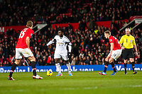 Saturday 11 January 2014 Pictured: Wilfried Bony tries to pass the ball through <br /> Re: Barclays Premier League Manchester Utd v Swansea City FC  at Old Trafford, Manchester