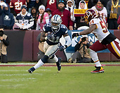 Dallas Cowboys running back Ezekiel Elliott (21) carries the ball in the second quarter against the Washington Redskins at FedEx Field in Landover, Maryland on Sunday, October 21, 2018. Washington Redskins linebacker Mason Foster (54) pursues on the play.<br /> Credit: Ron Sachs / CNP