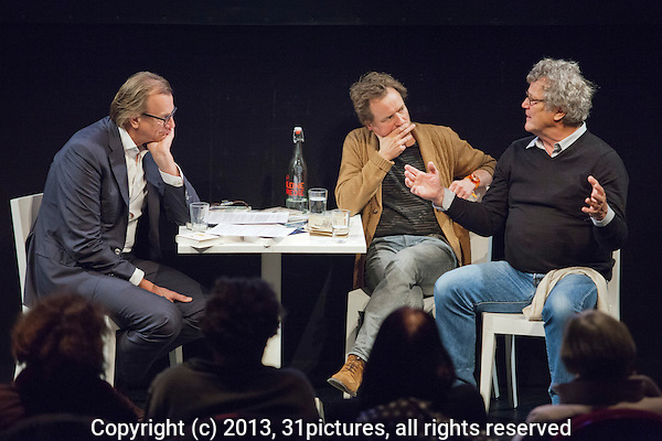 The Netherlands, Amsterdam, 22 November 2013. The 26th International Documentary Film Festival Amsterdam - IDFA 2013. In the IDFA in de Kleine Komedie programme; Talk about documentary Dier, bovendier. From left; Chris Kijne (moderator), writer Frank Westerman and filmmaker Hans Fels. Photo: 31pictures.nl / (c) 2013, www.31pictures.nl