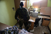 Pro-Russian militia search for abandoned guns and ammunitions at the Mirniy Border guard