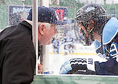 Red Gendron (Maine - Head Coach) talks to Devin Shore (Maine - 94) through the door during warmups. - The University of Maine Black Bears defeated the Boston University Terriers 7-3 (2EN) on Saturday, January 11, 2014, at Fenway Park in Boston, Massachusetts.
