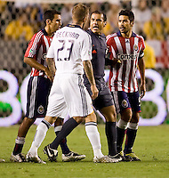 LA Galaxy midfielder David Beckham and Chivas USA midfielder Paulo Nagamura argue as referee Baldomero Toledo separates them. The LA Galaxy defeated Chivas USA 1-0 to win the final edition of the 2009 SuperClásico at Home Depot Center stadium in Carson, California on Saturday, August 29, 2009...