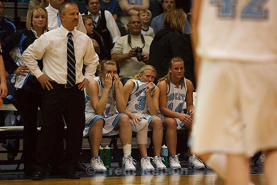 Taylorsville - On the bench in the final minutes, Sky View's Amy Andrus (left to right), Megan Hansen and Nicole Hansen. Sky View vs. Springville High School girls basketball, 4A State Championship tournament Friday February 27, 2009 at Salt Lake Community College.