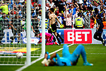 Christopher Schindler of Huddersfield Town celebrates after scoring the winning penalty ahead of a dejected Ali Al-Habsi during the SkyBet Championship Play Off Final match at the Wembley Stadium, England. Picture date: May 29th, 2017.Picture credit should read: Matt McNulty/Sportimage