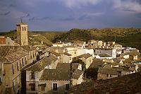 City scene, tile rooftops and hills across River Tajo. Tower at left is Church of San Miguel. Toledo Castilla-La Mancha Spain.