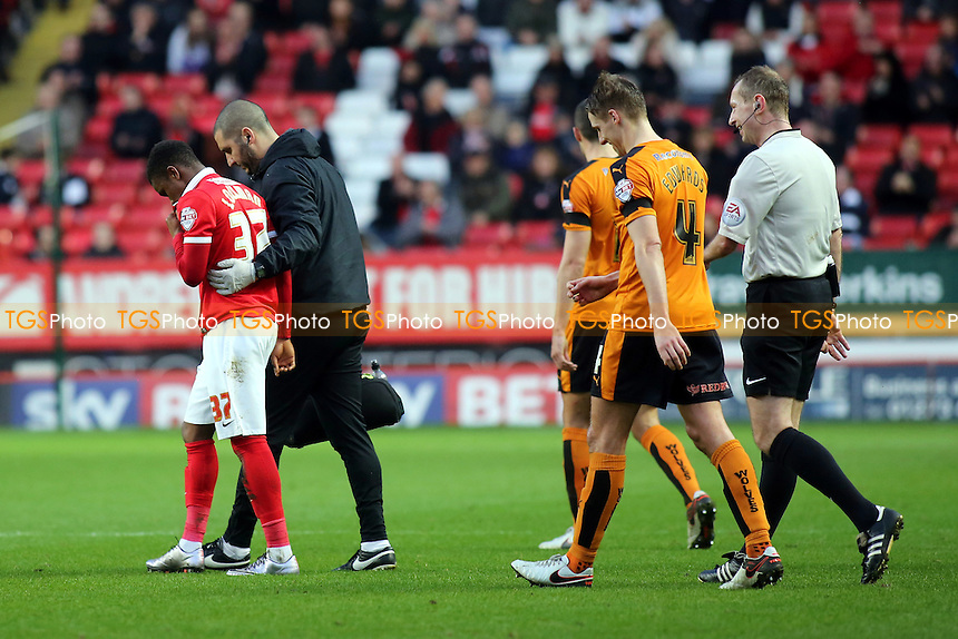 Ademola Lookman of Charlton is helped off the pitch just prior to half-time during Charlton Athletic vs Wolverhampton Wanderers, Sky Bet Championship Football at The Valley, London, England on 28/12/2015