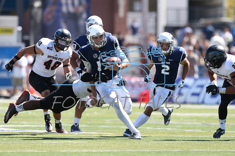 Nevada's quarterback Cody Fajardo (17) runs against Southern Utah in the first half of an NCAA college football game on Saturday, Aug. 30, 2014 in Reno, Nev. From left, Southern Utah's Taylor Pili (48), Nevada's Richy Turner (2) and Southern Utah's Toa Afatasi (26) were in on the play. (AP Photo/Cathleen Allison)