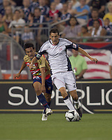New England Revolution midfielder Marko Perovic (29) accelerates and Monarcas Morelia midfielder Ismael Pineda (6) pursues. Monarcas Morelia defeated the New England Revolution, 2-1, in the SuperLiga 2010 Final at Gillette Stadium on September 1, 2010.