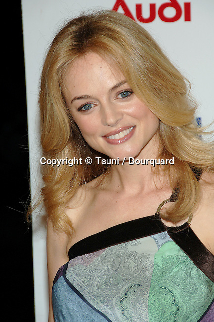 Heather Graham arriving at the BOBBY  Premiere at the Chinese  Theatre in Los Angeles.<br /> <br /> headshot<br /> smile <br /> eye contact