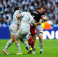 Alex Goode of Saracens takes on the Racing 92 defence. European Rugby Champions Cup Final, between Saracens and Racing 92 on May 14, 2016 at the Grand Stade de Lyon in Lyon, France. Photo by: Patrick Khachfe / Onside Images
